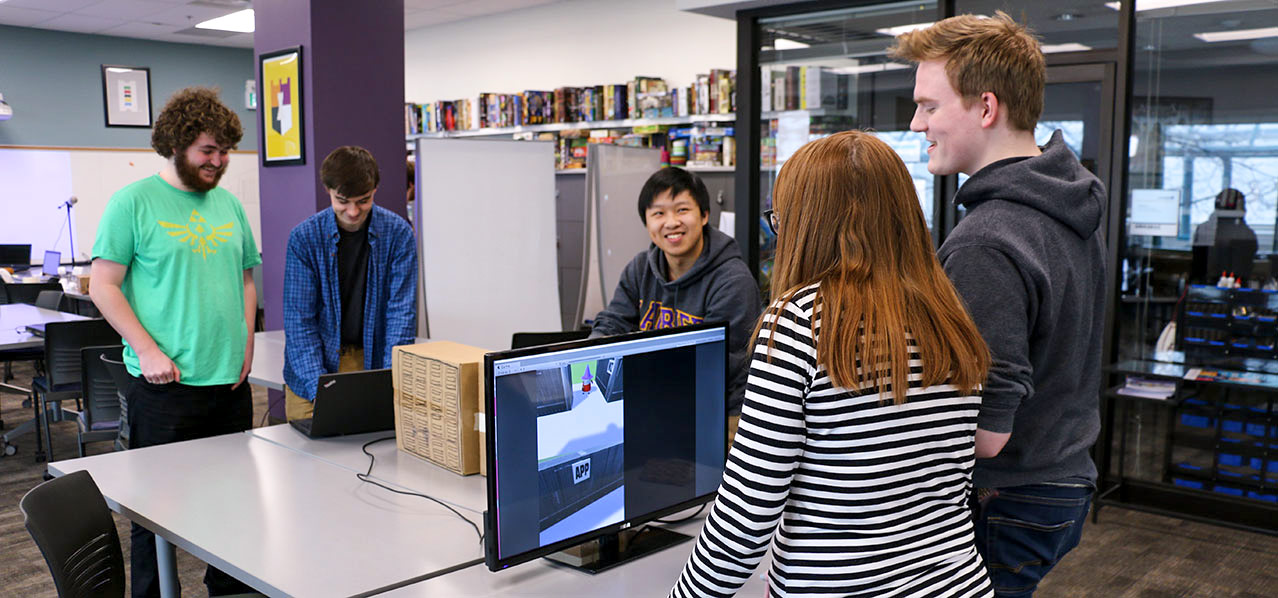 students standing around computer