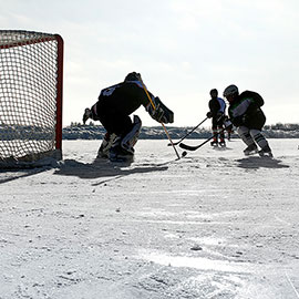 playing hockey on outdoor rink