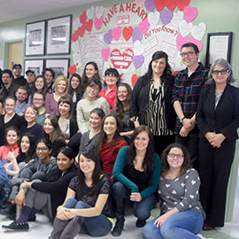 Group photo of Laurier education students with paper pledge hearts