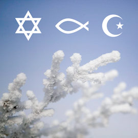 Image of religious symbols over a snowy tree branch