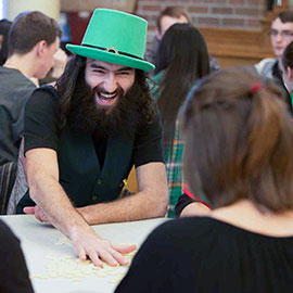 Man in green hat laughing
