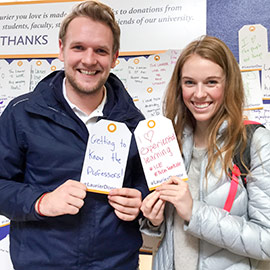 Students holding up tags with thank you messages