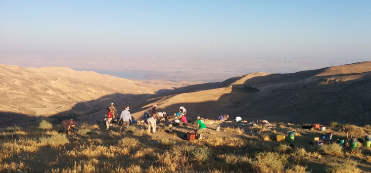 Students in Jordan overlooking a mountain range
