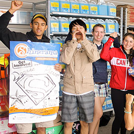 students with Shinerama posters in front of grocery store