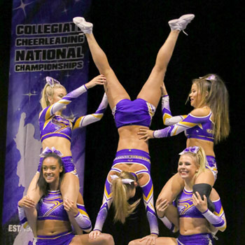 Laurier cheerleaders executing stunts