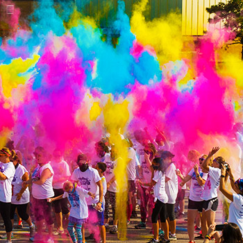 Bursts of colour fill the air at the 2017 fun run