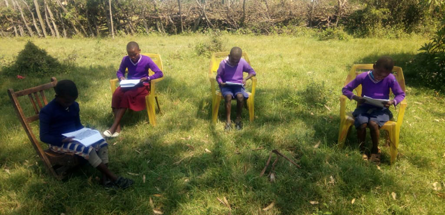 Students reading on chairs in Kenya