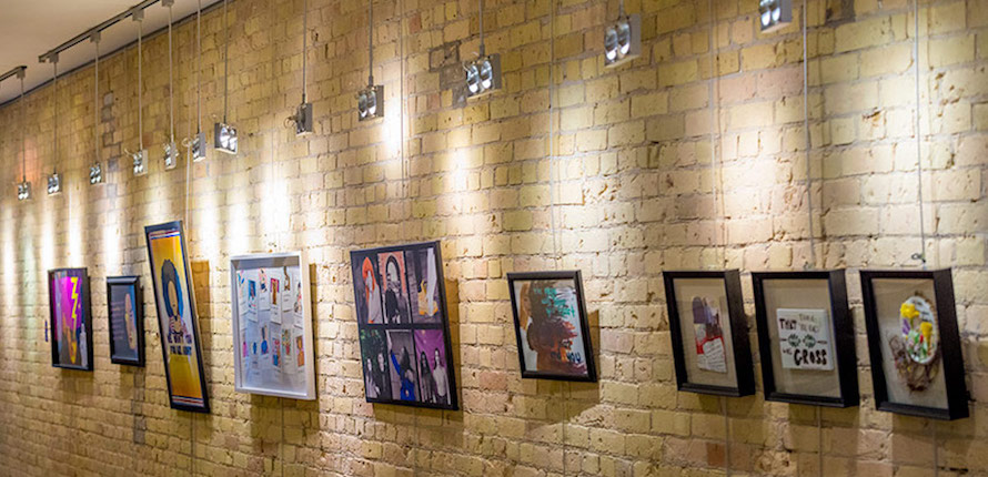 Yellow Brick Wall Pictures Hanging On A